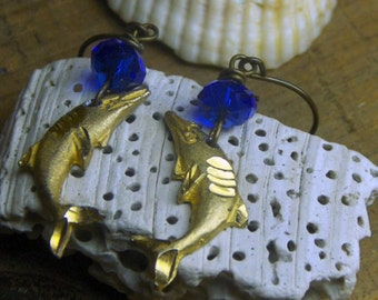The Delphic Blue Earrings. brass Dolphins and royal blue Czech glass rondelle earrings.handmade by Chymiera on Etsy