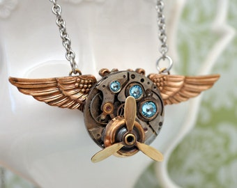 steampunk wing necklace, AVIATION, vintage watch movement necklace with vintage brass military wing badge and movable propeller