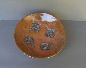 Large Stoneware Bowl Glazed in Glossy Copper, with Embossed Aztec Bird Designs in Gold