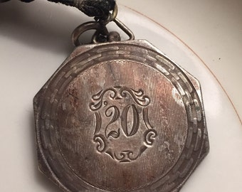 Antique Sterling silver 20th Anniversary Octogonal Locket
