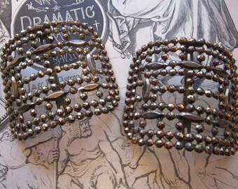 2 antique steel cut buckles - marked M.G. France - dark color