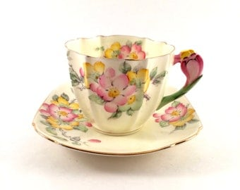 Yellow Paragon Teacup with flower handle / Apple Blossom registered / Made in England