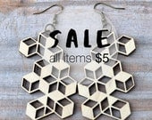 3D cubes illusion. Earrings in laser cut wood.