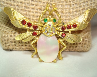 1960s Mother of Pearl with Red and aurora Borealis Stones Winged Bug Pin.