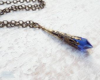 ENCHANTRESS Cobalt Blue Glass Old World Pendulum Necklace with aged brass filigree