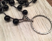 Elegant Necklace Doubles as Eye Glass holder Black beaded crocheted over the head or bead closure Mother's Day Cool Useful Jewlery