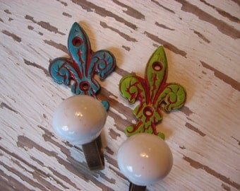 Small Brass Wall Hook Fleur de Lis with White Ceramic Knob Traditional Farmhouse Cottage Style Pictured in Green H-16