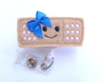 Badge Reel ID Holder Retractable - Stick it - Smiley face blue bow - tan black white felt band aid - Nurse RN pediatrician school nurse