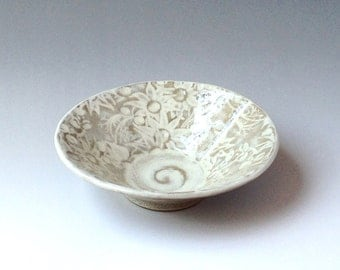 Stoneware bowl in white and buff glaze with Australian Flannel Flower design
