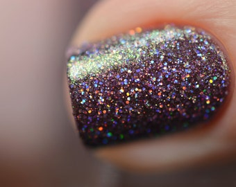 "Nail polish - ""Subtle Silence"" silver holographic glitter in a dark purple base"