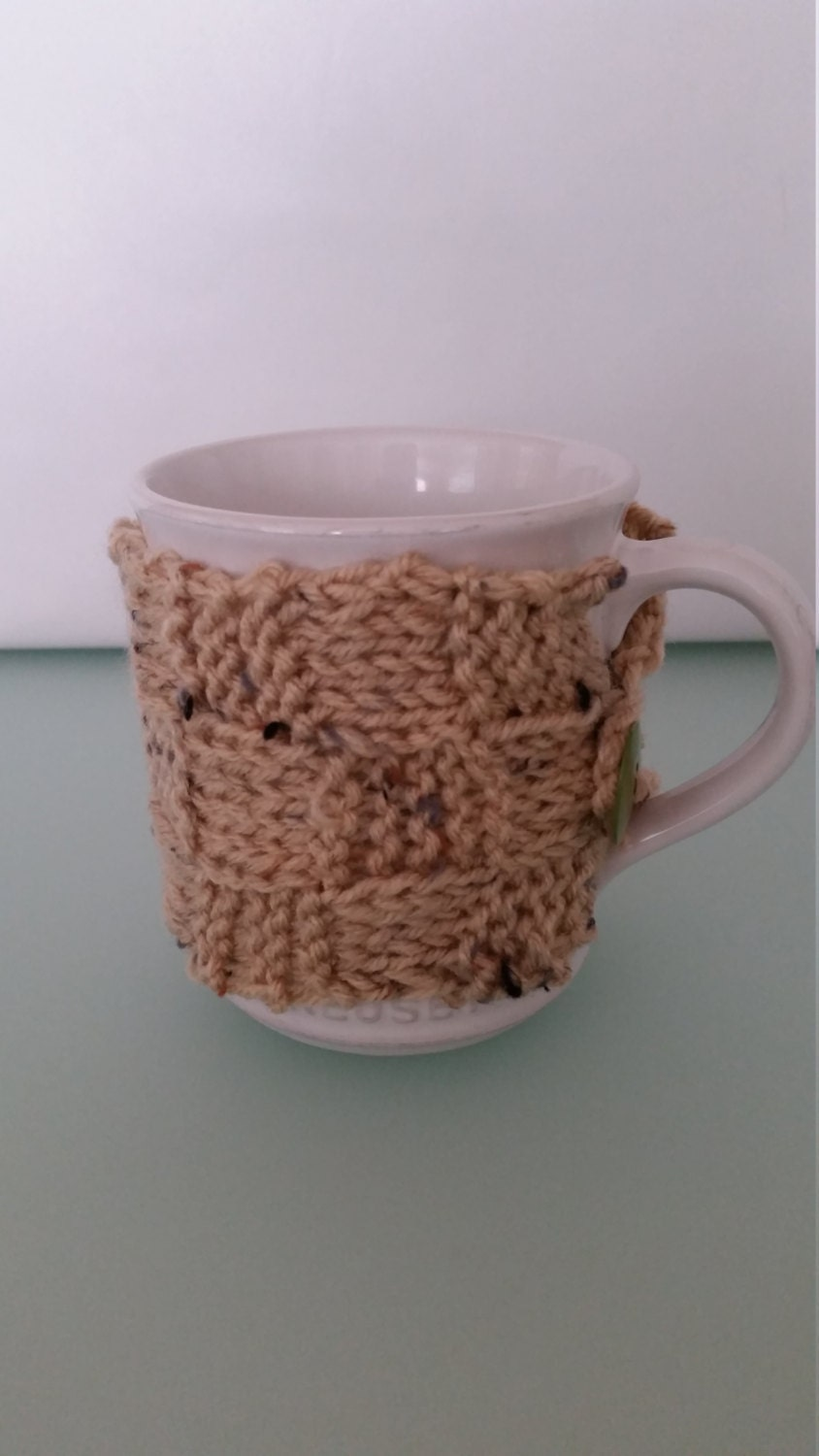 Coffee mug cozy knitted in basket weave pattern