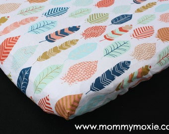 Multi Colored Feathers on White Changing Pad Cover -Nursery Bedding for the Modern Adventurer- Gender Neutral - by Mommy Moxie on Etsy