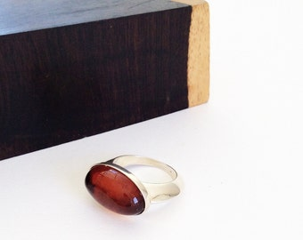 simple oval dark amber ring, size 8