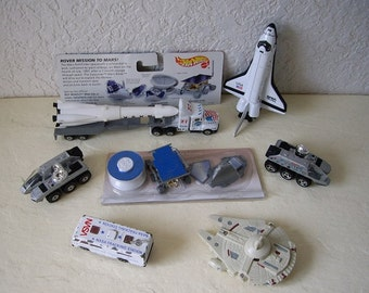 Space vehicles and toy collection.  Hot Wheel size.