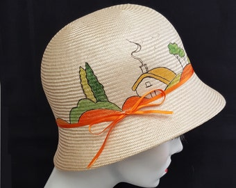 Hand painted straw cloche hat with Art Deco style illustration. Parabuntal straw cream with orange small size size green  20s cloche