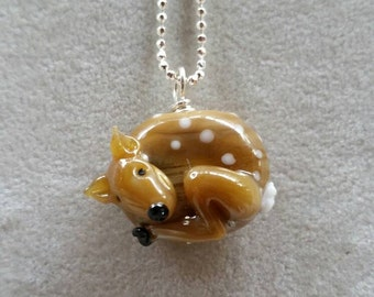 Lampworked Glass Fawn pendant.