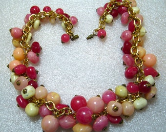 Vintage lucite early plastic pink balls necklace