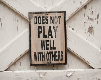 Does not play well with others sign made from reclaimed plywood