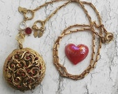 Lovers Locket of Captured Grown Love with removable red glass heart inside Gold tone jewelry necklace