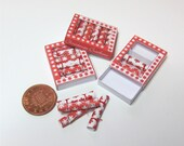 Dolls house miniature box of six traditional red and white Christmas crackers
