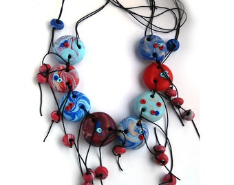 Polymer clay necklace blue and red,with sliding knot