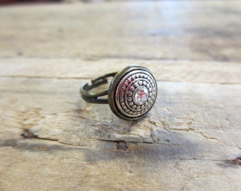 Vintage style silver medallion ring with center rhinestone and antique brass base, adjustable