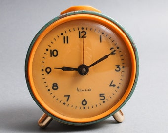 Vintage metal mechanical alarm clock Vityaz from Soviet Russia