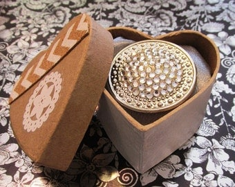 Ring made from a vintage earring and will be coming to you in a cute gift box perfect for giving or receiving