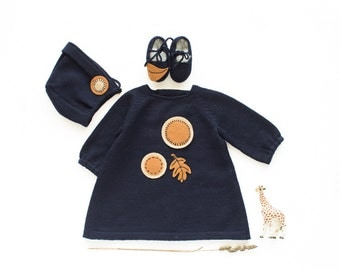 A knitted baby dress, cap and shoes with felt circles and leaves. 100% wool. READY TO SHIP size newborn.