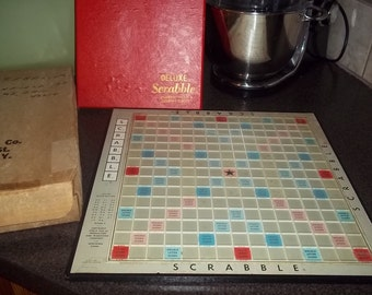 Swivel (Turntable) Scrabble Game dated 1954 with all tiles and all tile holders and pegs in original box!