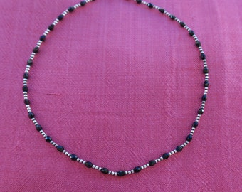 Sterling silver and faceted onyx necklace