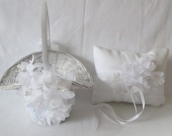 Romantic white wedding set of flower girl basket and ring bearer pillow. Traditional, classic ceremony.