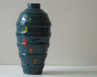 Vintage modern turquoise pottery vase with yellow red and orange accents