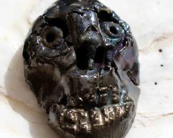 Ceramic Raku Decayed Face Pendant
