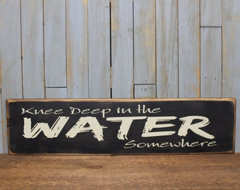 """Wooden Sign """"Knee deep in the water somewhere"""""""