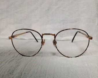 Unique frame made by Eye Q Eyewear, brown-Demi color 51/19  140 temple size