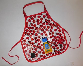 Cute as a red ladybug wipe off vinyl oil cloth school play apron smock with pockets for art supplies for messy projects, kids ages 1 - 6