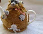Handknitted tea cosy cover with mice