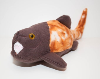 Extinct Dunkleosteus Fossil Plush in Orange and Brown