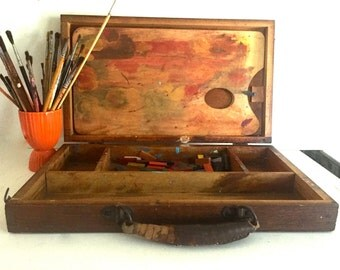 Vintage wooden artist's carrying case with palette inside.