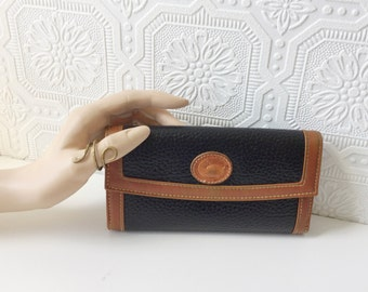 Dooney & Bourke Wallet, Black Pebbled Leather with Brown Accents, Bifold Clutch, All Weather, Places for Bills, Change and Checks, Vintage