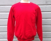 1980's blank red sweatshirt, fits like a medium