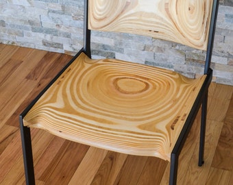Modern custom carved wood chair and powder coated steel legs