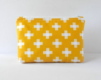 Woman's padded beauty pouch cosmetics make up travel bag in geometric cross print in sunshine yellow and white in large.