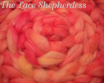 Hand dyed Coopworth wool. Pin draft roving. Tequila Sunrise