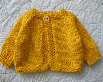 Handmade baby sweater ...........golden yellow cardigan with 'flower' button