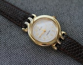 Vintage Timex ladies watch gold tone with new brown lizard strap