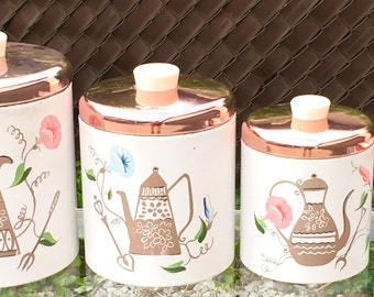 Set of 4 Nesting Ransburg Metal Kitchen Canisters
