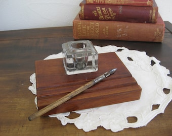 Retro glass inkwell on wooden stand