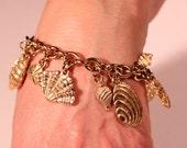 Vintage 90s Bracelet Gold Tone Bracelet Trinkets Dangling Bracelet French jewelry Brand AGATHA
